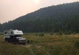 BC Canada rv rental vacation camper in field photo